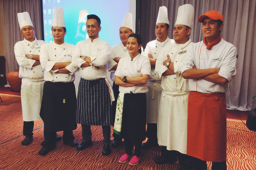 Chef Sau del Rosario (in striped apron), US Potato Board consultant, is joined by Chef Bea Policarpio (center) and the culinary team behind the US Potato Safari Exhibition Lunch at the Manila A & B Function Rooms, the Marco Polo Plaza Hotel, Cebu City on February 5, 2014.