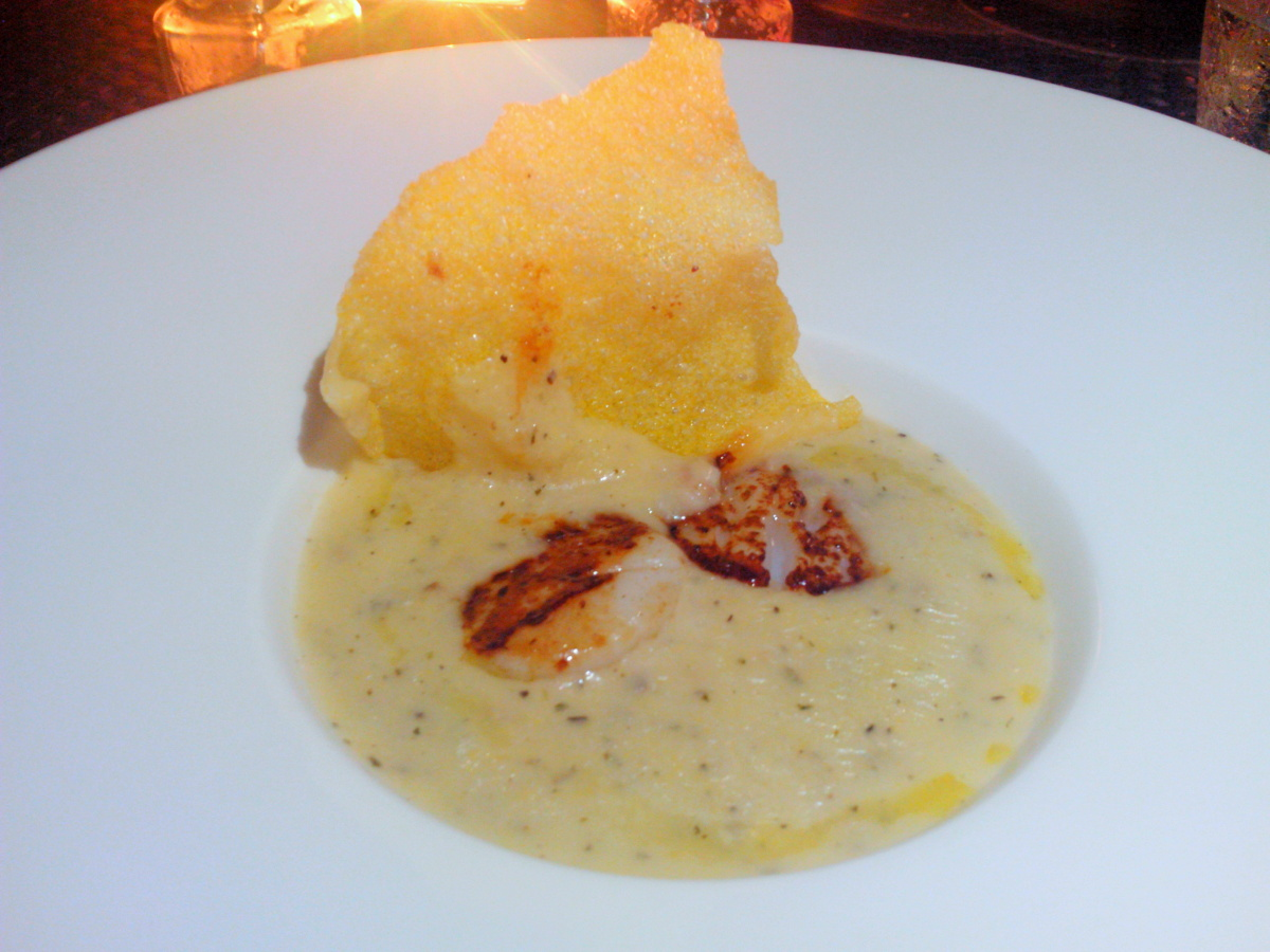 Pan seared scallop in truffle scented polenta soup topped with parmesan tips.